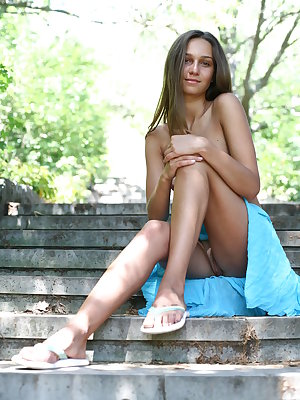This staggering nude angel has got the most startling body and she gaily demonstrates it on the stone stairs in the park.