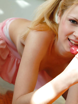 As the class was over this fabulous teen set her mind to stay at the class-room and to lick her lollypop on the floor without clothes.