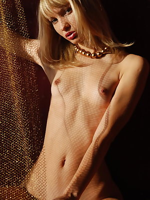 Fully nude killing blonde angel shows all wonderful treasures without any shade of shame in red bedroom.