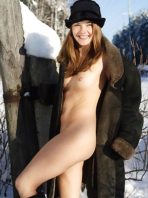 Classy babe in sexy lingerie and high fur boots reveals her awesome body at the snow-clad country house