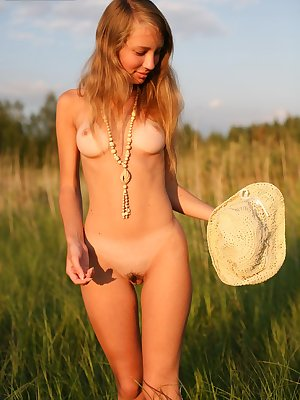 Very nice looking blonde teen shows off her prefect breasts and butt walking outdoors