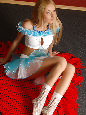 Fresh gorgeous blonde in a blue skirt undressing and showing her nice shapes