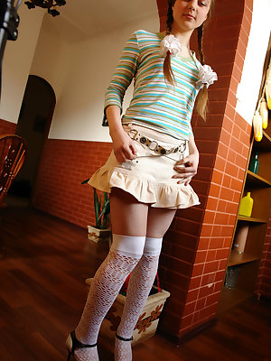 First-grade coed comes home from college and takes off her short skirt and stripy blouse