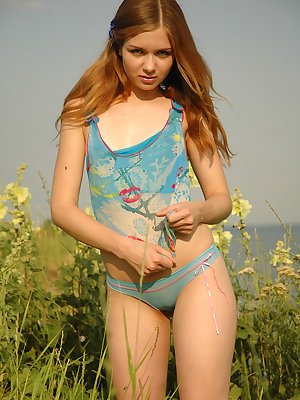 Gorgeous teen in a blue vest and panties stripping them slowly exposing her natural beauty