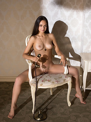 Dark haired sensual girl with fascinating eyes spreads her legs and shows off her unique feminine curves while ordering food by phone.