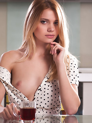 This flawless blonde babe has the most seductive stare that she uses to show you her sexy little world.