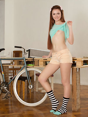 This hot babe embraces her flawless shapes her room where she puts her booty beside the bicycle she loves so much.