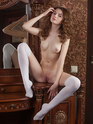 This classy doll knows how to show off her flawless body with a serious face as she poses in those sexy stockings.