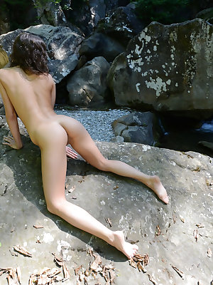 The sunshine burns her delicate skin as she puts that flawless booty on a rock, to show you that gorgeous pussy.