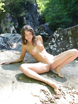 This lovely brunette makes nature richer with leaving some of her juicy pussy wet on the rocks as she poses.