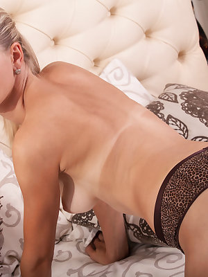 Sweet blonde beauty slowly undresses from top to bottom as she reveals her hot booty and irresistible hot curves.