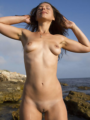 Petite brunette babe showing off her glamorous body as she bathes in the sunshine on a hot afternoon.