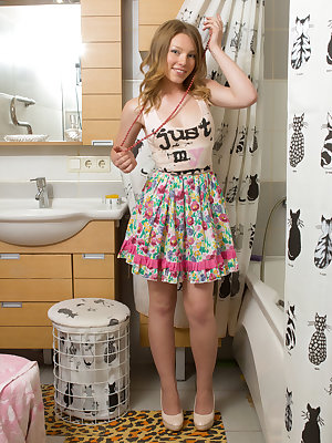 Amazing blonde poses in every corner of her bathroom, in poses that show a lot of her juicy little holes.
