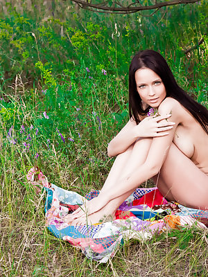 A pleasant afternoon in the woods always can raise the good feeling of this lovely girl. Super sexy, nude outfit, heavily hot.