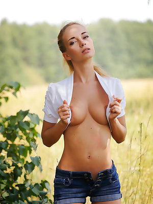 Sexy blonde hair, deep blue eyes, half smile calling for great fun. Take a big breath and enjoy the soft beauty of this babe.