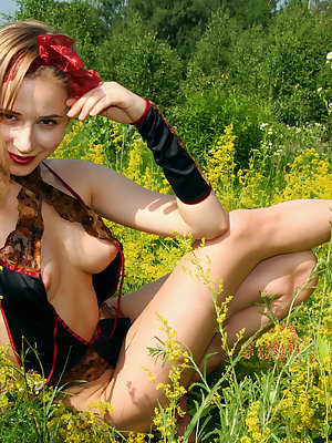 Incredible teen honey stripping and showing attractive breasts and hairy pussy in a field.