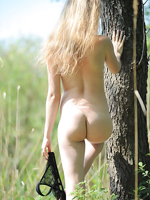 Pretty long haired teen sowing sexy small tits, tight ass and charming pussy in forrest.