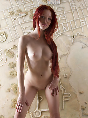 Stunning redhead with perfect big tits and slim body strips down and shows off everything.
