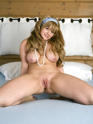 Blue eyed hottie with all natural big luscious tits and juicy twat showing off on a bed.