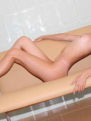 Naughty Amber posing with a huge rubber cock in her pussy and cumming real hard during the shooting.