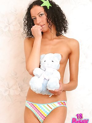 Georgeous topless Kelly poses with teddy bear showing off her smooth twat.