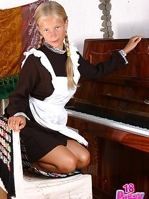Blue-eyed cutie Anna pretends she is a schoolgirl playing the piano and getting naked.