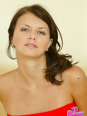 Nasty Claudia wears tiny red panties and enjoys caressing her wet tight slit with hands and fingers.