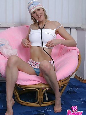 Cute young Tanya on a chair gets rif off her sexy panties and sreads her nice legs showing her pink.