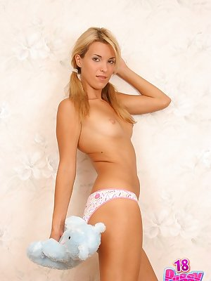 Young blonde Silvia reveals her awesome tits and pink tiny love bud.