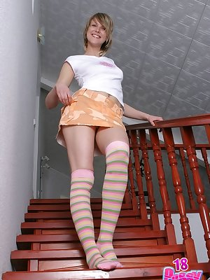 Tanya poses on stairs near by a home roof revealing her oozy pink slit.
