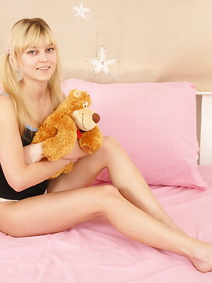 Very sexy teen blonde spreads her long sexy legs to take this creamy penis deep inside her slutty cunt