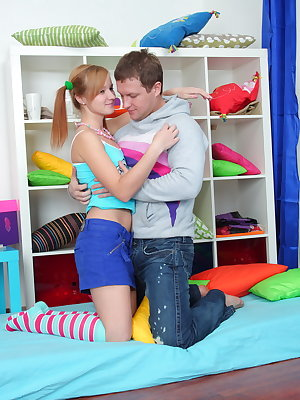 Glamorous teen in long striped socks and beads around her neck fucking and getting cumshot.