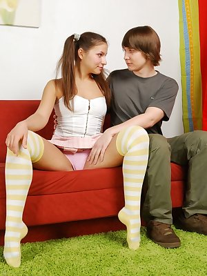 Lustful teen hottie enjoys some intense hardcore fucking and tasty oral sex on a red couch.
