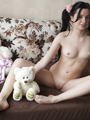 This pale cutie is having some fine fun in her bedroom where she freely embraces all her sweet curves.