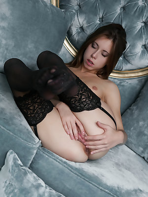 Marvelous teen charmer in sexy black stockings showing wet quim and tight ass on the couch.