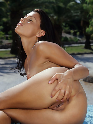 18 year old Spanish girl Aneta Keys plays with a sex toy in the garden