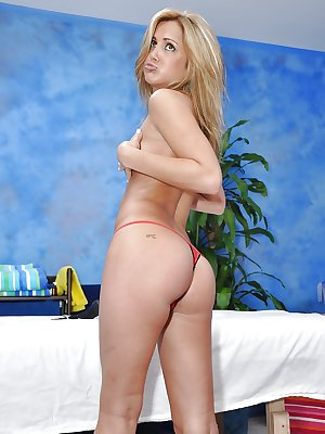 Young babe denudes her sexy curves and poses at a massage table
