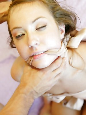 Young babe Maddy Oriley deepthroats a huge cock and fucks in bondage