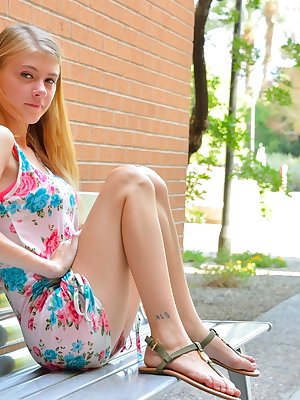 Young cutie Hannah flashes nude upskirt before getting naked in public