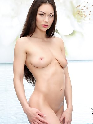 Russian university aged girl Arwen Gold pleasures her hairless pussy once nude