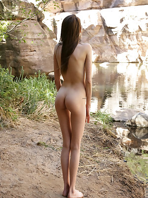 Skinny teen Aria Haze shows off her thin body masturbating naked in the woods