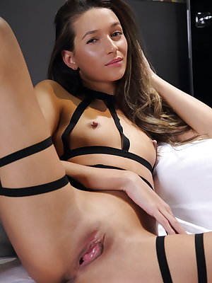 Teen solo girl showcases her hairless pussy in revealing attire
