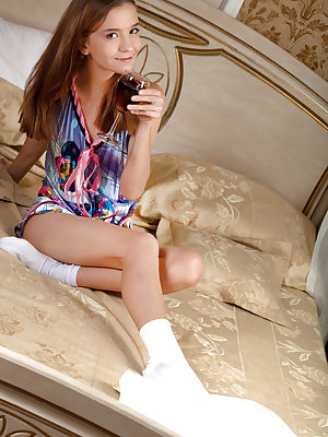 Little cutie Alisabelle in white socks showing tiny ass and twat on the bed