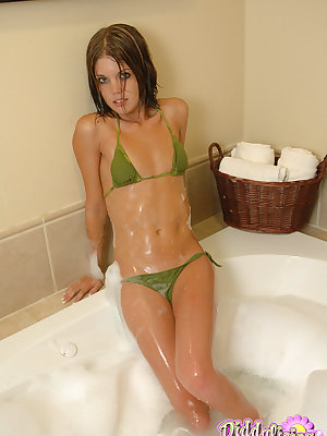 Flat chested Diddylicious sheds her bikini in the bath showing soapy hot ass