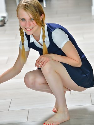 Tiny schoolgirl Sharlotte in uniform bends over for a naked upskirt outside