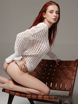 Beautiful redhead Helga Grey in sheer sweater flaunting her perfect big tits