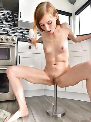 Ginger babe with small breasts Eva fucks a huge stick at home