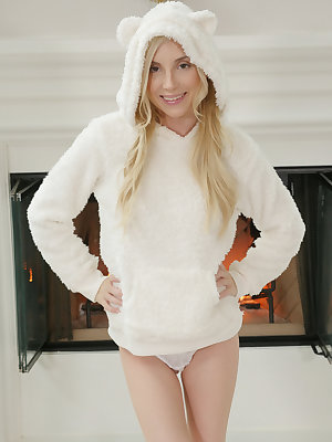 Petite blonde girl Piper Perri disrobes to pose naked on a rug