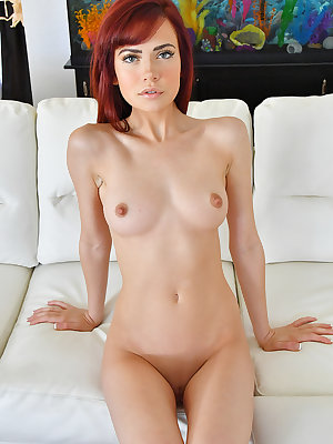 Hot redhead shows off the pink of her shaved pussy during nude posing debut