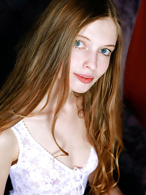 Beautiful skinny teen Mary Lane stares into the camera as she strips off naked